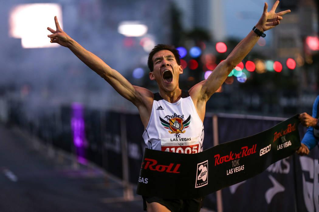 Matthew Liaw crosses the finish line winning the 10K men's run of the Rock 'n' Roll Las Vegas Marathon along the Strip near The Mirage in Las Vegas, Sunday, Nov. 12, 2017. Joel Angel Juarez Las Ve ...
