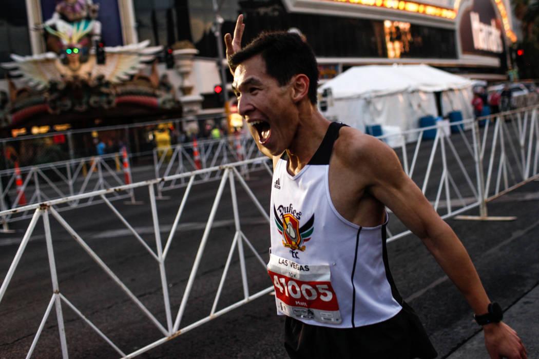 Matthew Liaw of Crownpoint crosses the finish line winning the 10K men's run of the Rock 'n' Roll Las Vegas Marathon along the Strip near The Mirage in Las Vegas, Sunday, Nov. 12, 2017. Joel Angel ...