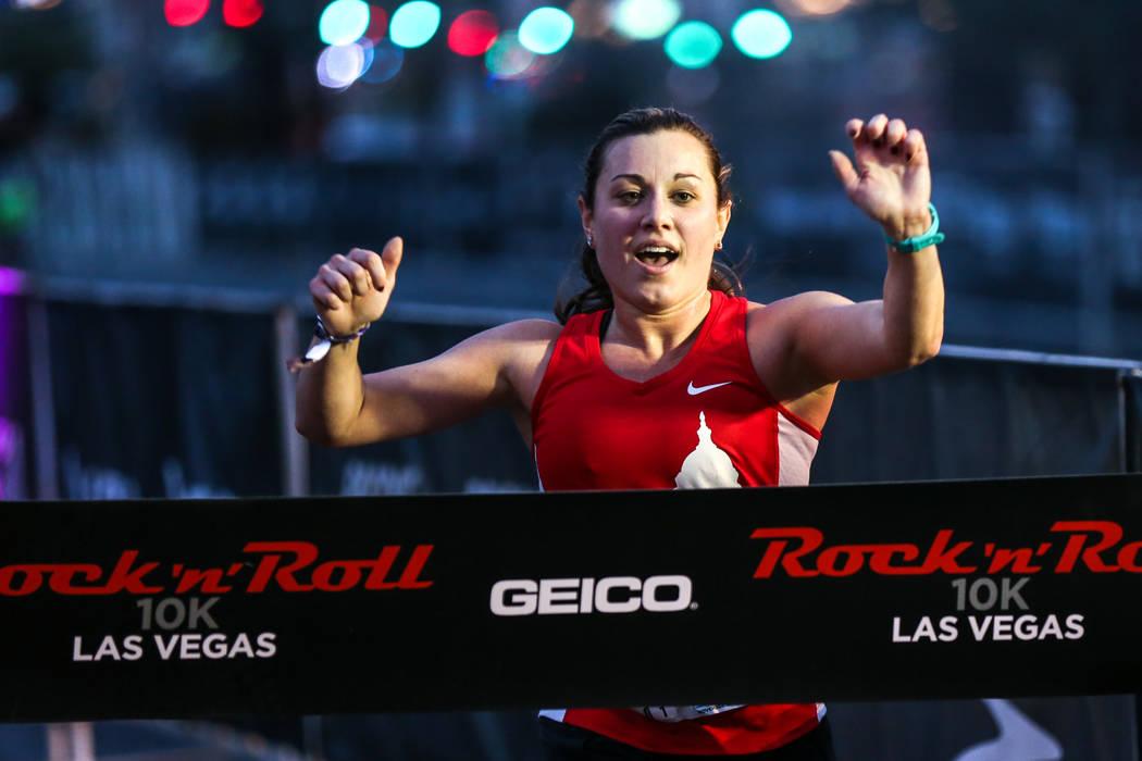 Daniel Sgro of Washington crosses the finish line at the 10K women's run of the Rock 'n' Roll Las Vegas Marathon along the Strip near The Mirage in Las Vegas, Sunday, Nov. 12, 2017. Joel Angel Jua ...