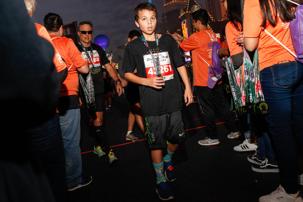 Darius Stamps of Spokane crosses the finish line at the 10K run of the Rock 'n' Roll Las Vegas Marathon along the Strip near The Mirage in Las Vegas, Sunday, Nov. 12, 2017. Joel Angel Juarez Las V ...