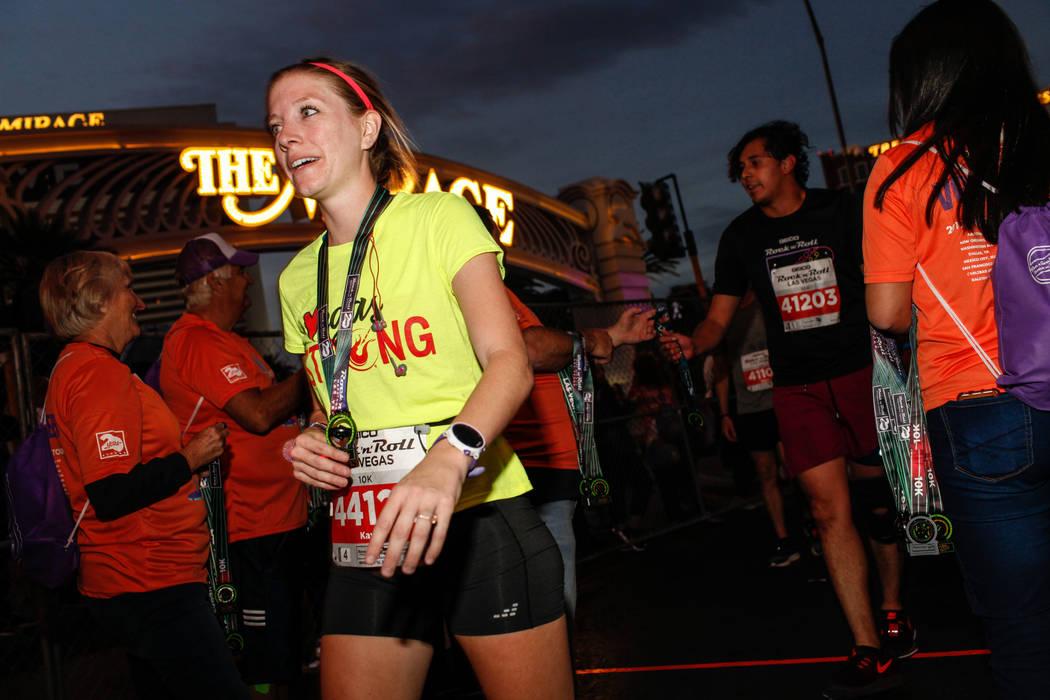 Kayla Hohlt of Austin crosses the finish line at the 10K run of the Rock 'n' Roll Las Vegas Marathon along the Strip near The Mirage in Las Vegas, Sunday, Nov. 12, 2017. Joel Angel Juarez Las Vega ...