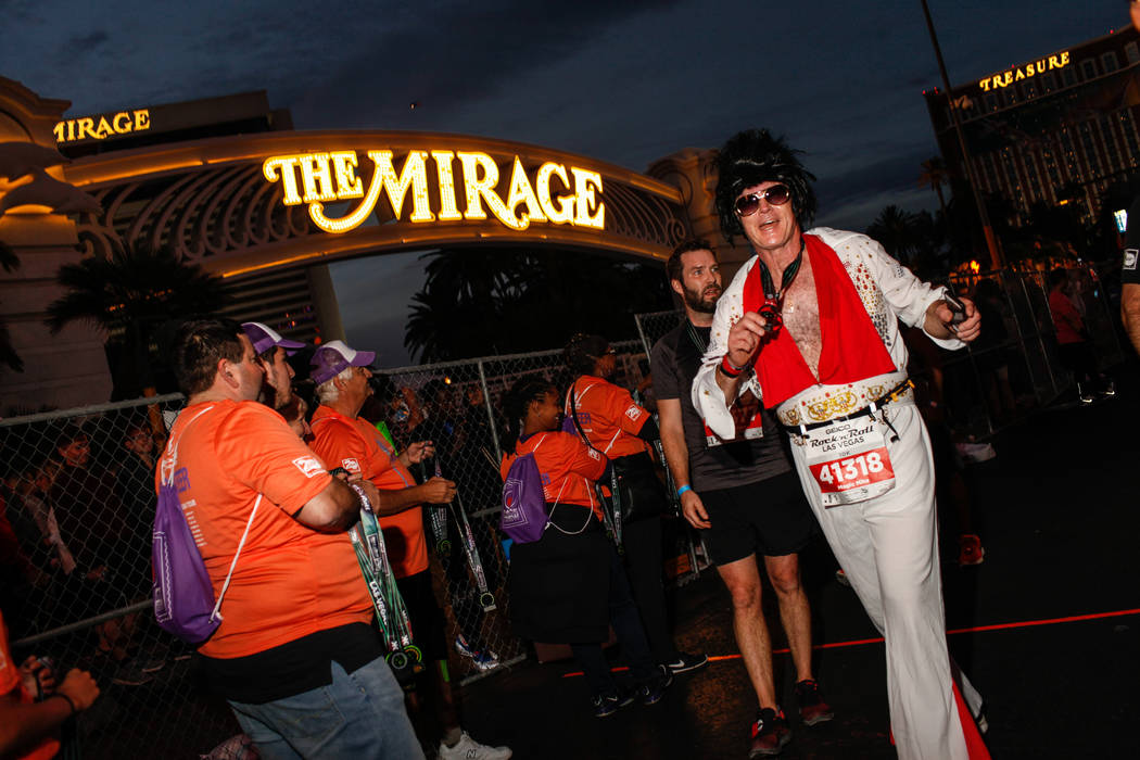 Mike Christie of Nepean crosses the finish line at the 10K run of the Rock 'n' Roll Las Vegas Marathon along the Strip near The Mirage in Las Vegas, Sunday, Nov. 12, 2017. Joel Angel Juarez Las Ve ...