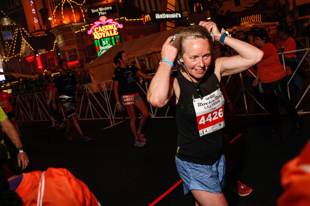 Catherine Baran of Sandspit crosses the finish line at the 10K run of the Rock 'n' Roll Las Vegas Marathon along the Strip near The Mirage in Las Vegas, Sunday, Nov. 12, 2017. Joel Angel Juarez La ...