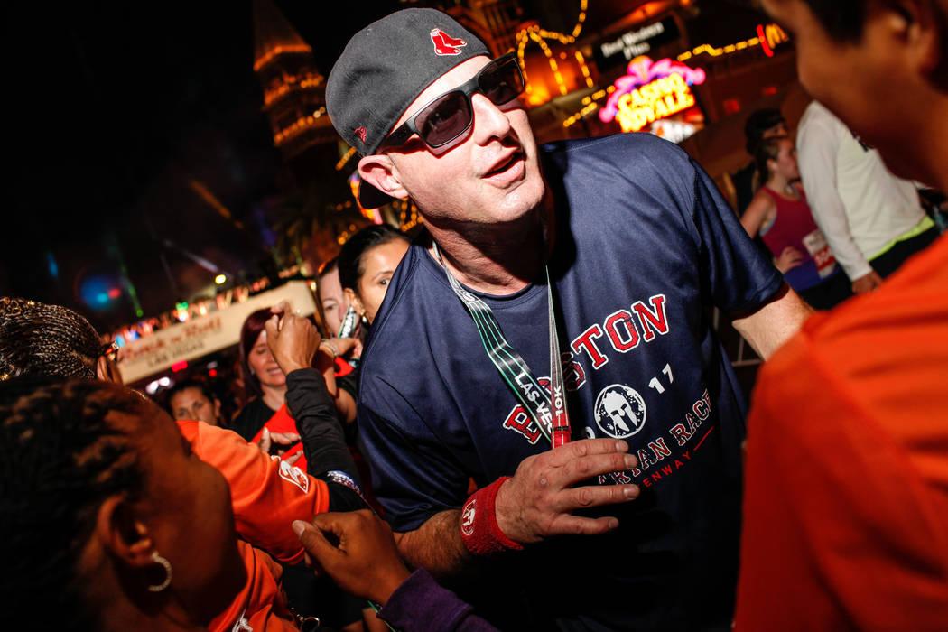 John Henley of Boston, 42, crosses the finish line at the 10K run of the Rock 'n' Roll Las Vegas Marathon along the Strip near The Mirage in Las Vegas, Sunday, Nov. 12, 2017. Joel Angel Juarez Las ...