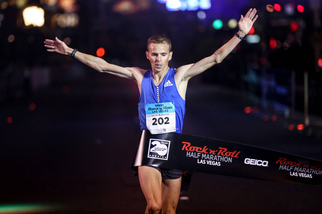 Jeffrey Eggleston of Boulder crosses the finish line for first place of the men's half marathon run of the Rock 'n' Roll Las Vegas Marathon along the Strip near The Mirage in Las Vegas, Sunday, No ...