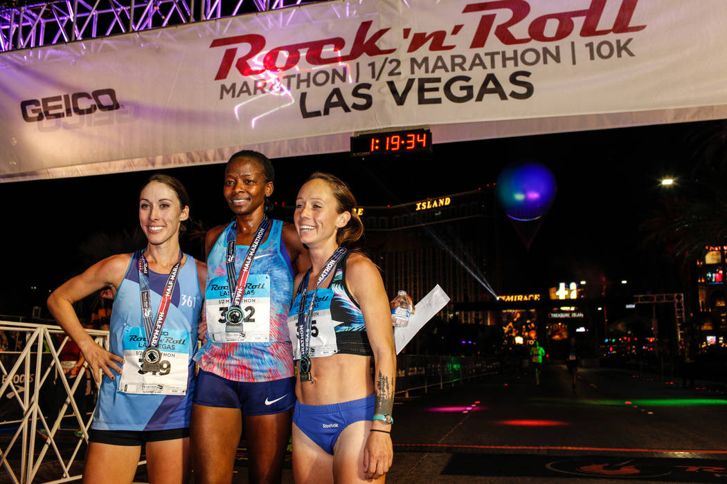 Second place winner Sarah Crouch, left, first place winner Janet Bawcom, and third place winner Georgia Porter, right, all of Flagstaff, gather for a photograph after completing the women's half m ...