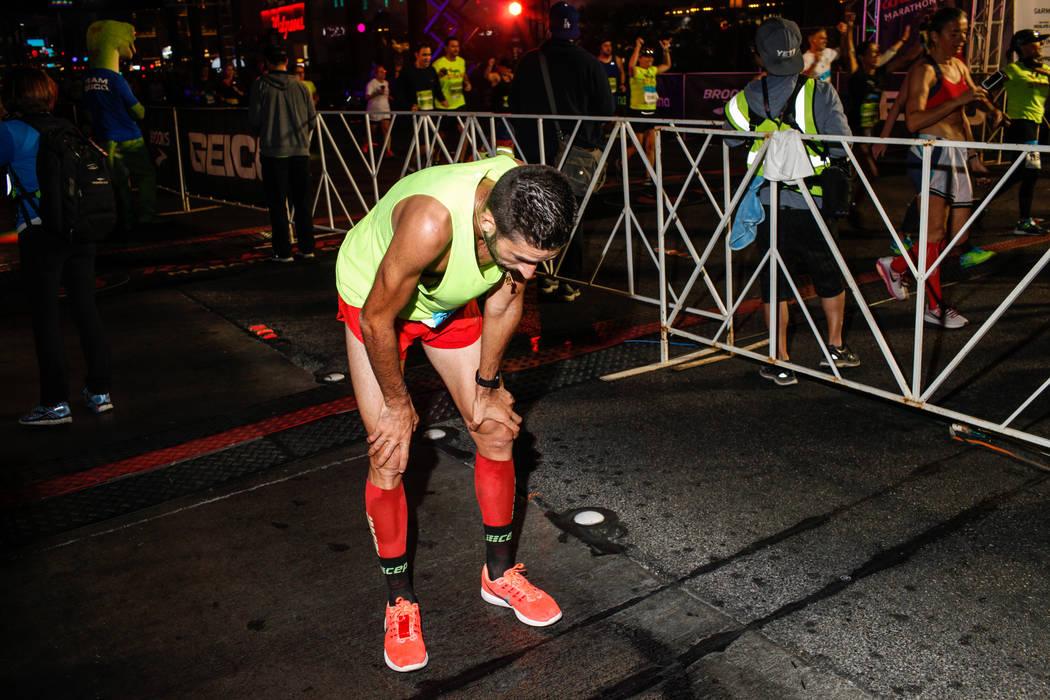 Gaetan Fetaud of Petit Bourg, France, crosses the finish line at the marathon run of the Rock 'n' Roll Las Vegas Marathon along the Strip near The Mirage in Las Vegas, Sunday, Nov. 12, 2017. Joel  ...