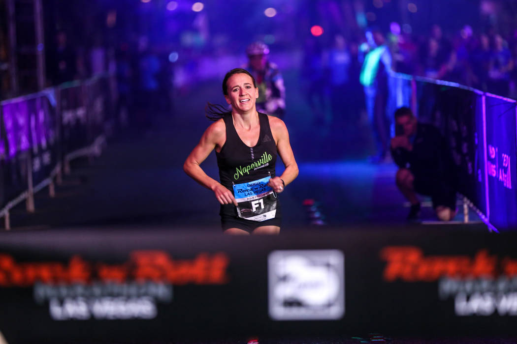 Marisa Hird of Naperville, Illinois runs toward the finish line before winning first place at the women's marathon run of the Rock 'n' Roll Las Vegas Marathon along the Strip near The Mirage in La ...