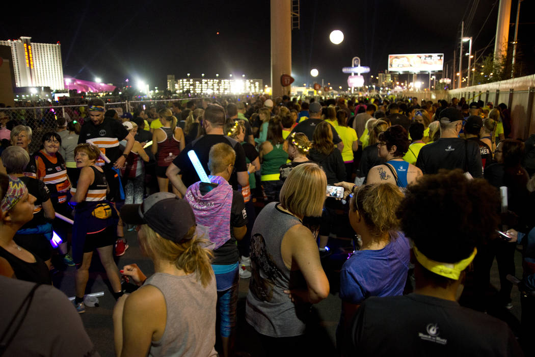 Runners wait for their corral number to be called to the start line during the 5K portion of the Rock ԮՠRoll Las Vegas Marathon at the Las Vegas Festival Grounds on The Strip on Saturd ...