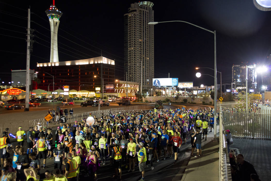 Runners wait for their corral number to be called during the 5K portion of the Rock ԮՠRoll Las Vegas Marathon at the Las Vegas Festival Grounds on The Strip on Saturday, Nov. 11, 2017. ...