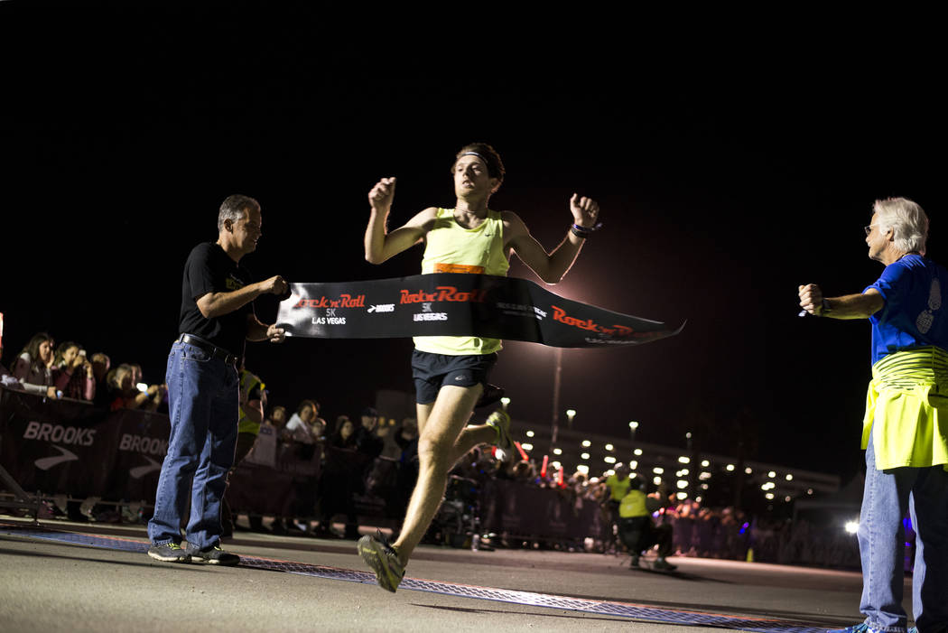 James McNally finishes first in the 5K portion of the Rock ԮՠRoll Las Vegas Marathon at the Las Vegas Festival Grounds on The Strip on Saturday, Nov. 11, 2017. Daniel Clark/Las Vegas R ...