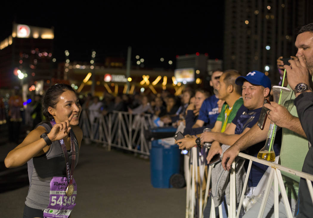 Nikki Regalado, the first female finisher, poses for a photo after the 5K portion of the Rock ԮՠRoll Las Vegas Marathon at the Las Vegas Festival Grounds on The Strip on Saturday, Nov. ...