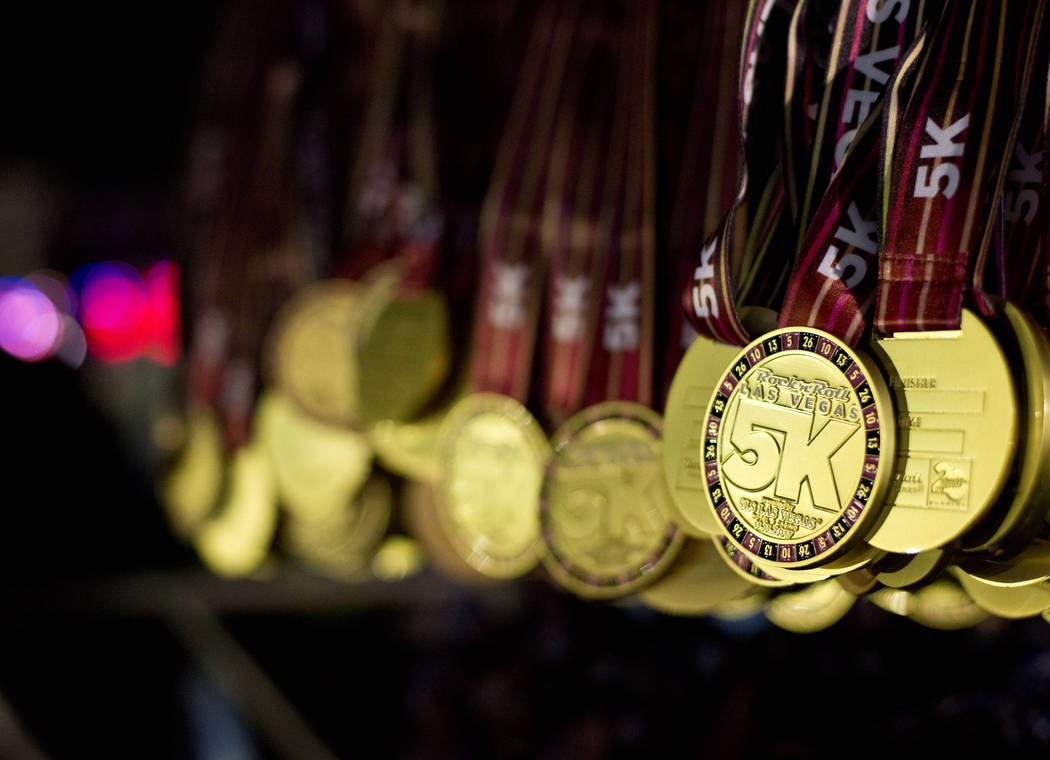 Hundreds of medals await the runners at the finish line of the 5K portion of the Rock ԮՠRoll Las Vegas Marathon at the Las Vegas Festival Grounds on The Strip on Saturday, Nov. 11, 201 ...