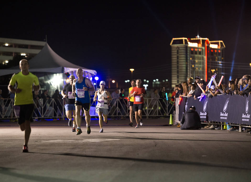 Runners complete the final stretch of the 5K portion of the Rock ԮՠRoll Las Vegas Marathon at the Las Vegas Festival Grounds on The Strip on Saturday, Nov. 11, 2017. Daniel Clark/Las V ...