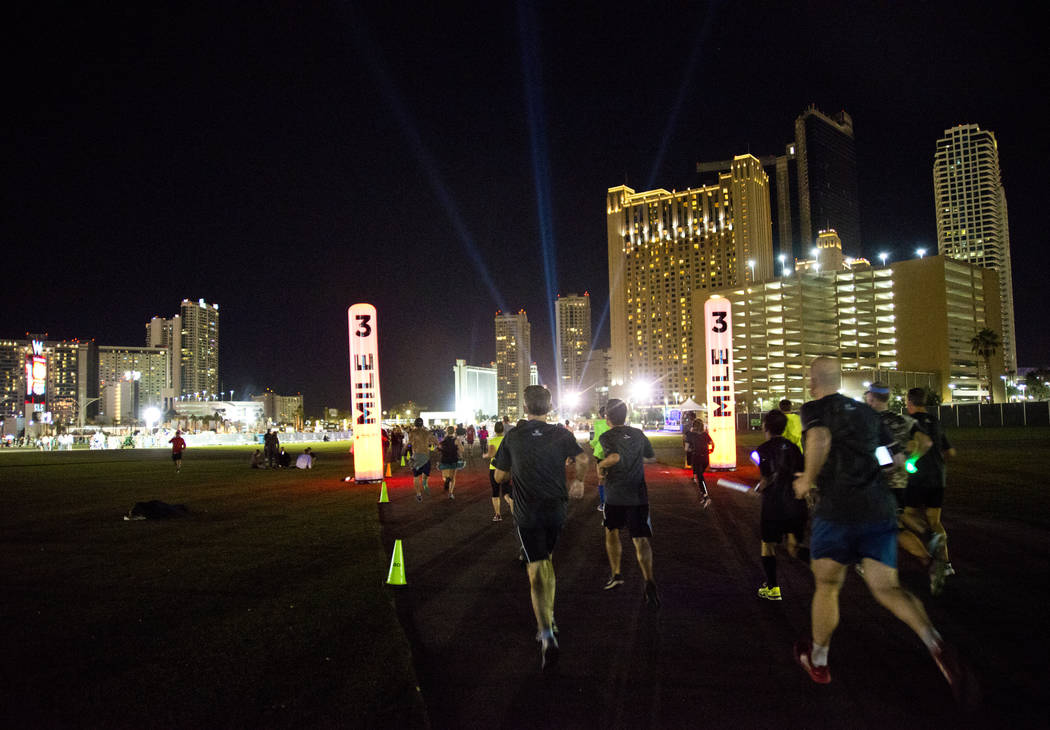 Runners approach the third mile of the 5K portion of the Rock ԮՠRoll Las Vegas Marathon at the Las Vegas Festival Grounds on The Strip on Saturday, Nov. 11, 2017. Daniel Clark/Las Vega ...