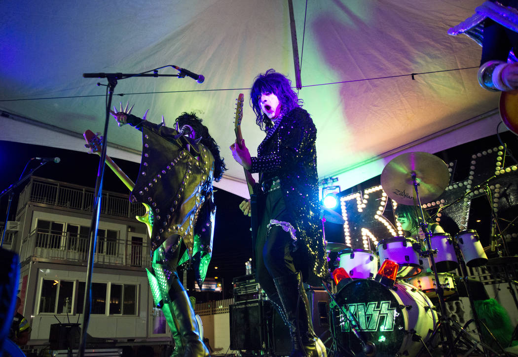 Kissed Alive, a KISS tribute band, performs during the 5K portion of the Rock ԮՠRoll Las Vegas Marathon at the Las Vegas Festival Grounds on The Strip on Saturday, Nov. 11, 2017. Danie ...