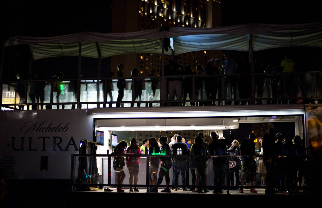People watch the Goo Goo Dolls perform after the 5K portion of the Rock ԮՠRoll Las Vegas Marathon at the Las Vegas Festival Grounds on The Strip on Saturday, Nov. 11, 2017. Daniel Clar ...