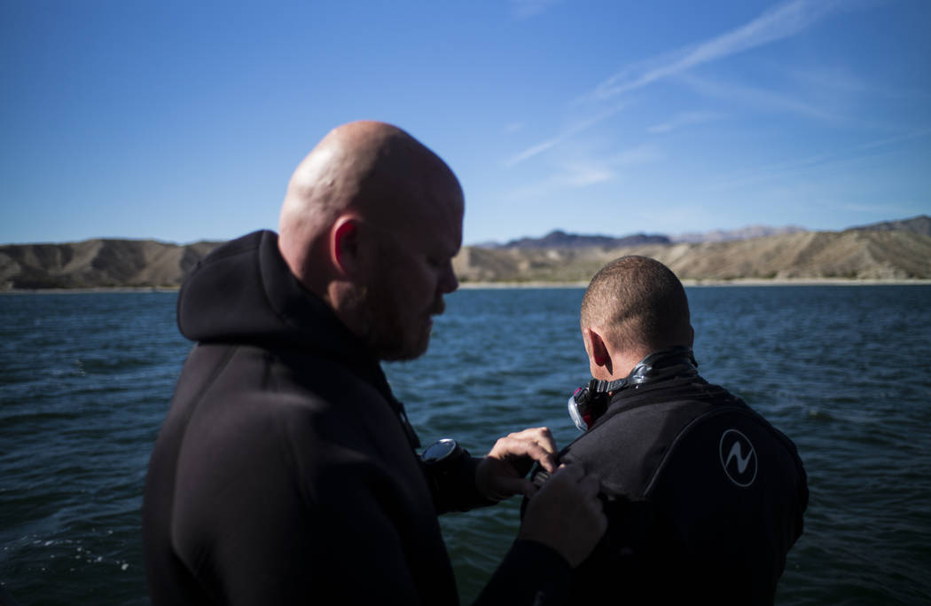 Army and Navy veteran Jeff Pickard, left, and Army veteran Daniel Gililland, both members of WAVES, or Wounded American Veterans Experience Scuba, a nonprofit group that promotes scuba diving for  ...