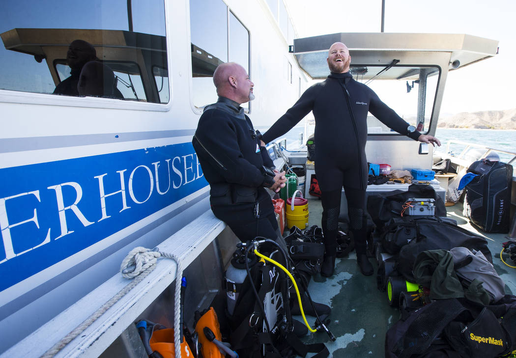 Army and Navy veteran Jeff Pickard, right, a member of WAVES, or Wounded American Veterans Experience Scuba, a nonprofit group that promotes scuba diving for disabled veterans, prepares for a subm ...