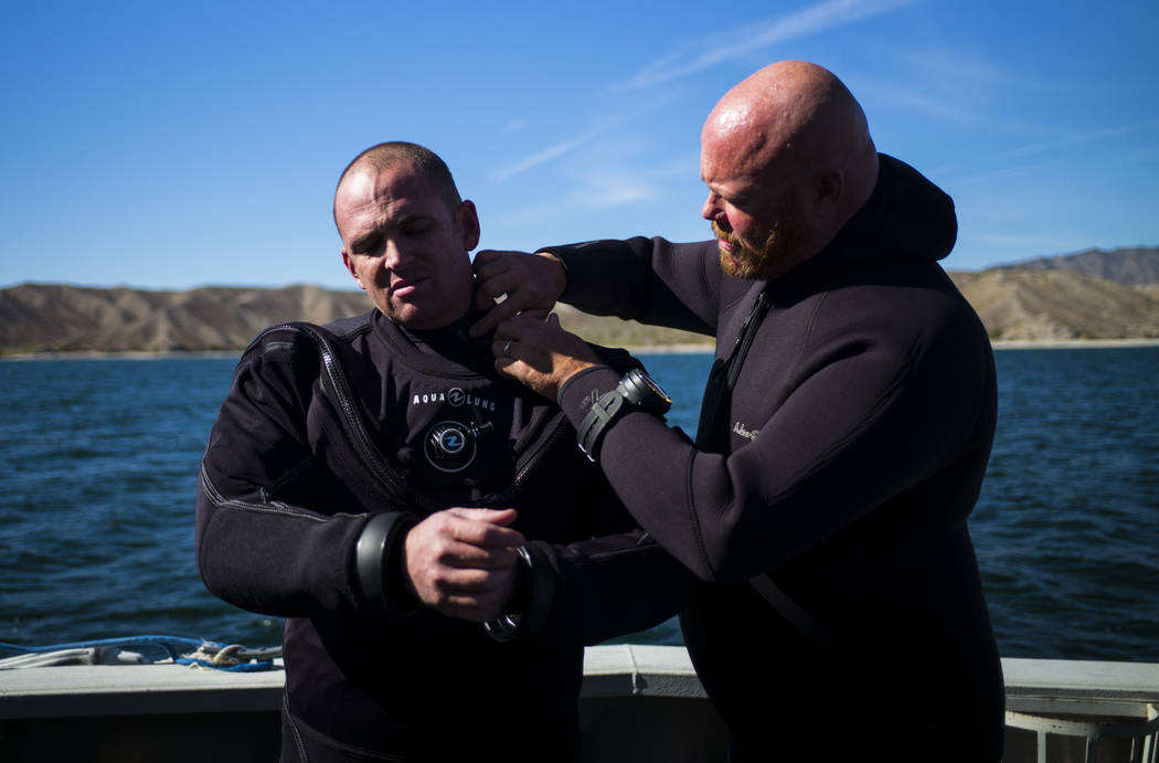 Army and Navy veteran Jeff Pickard, right, and Army veteran Daniel Gililland, both members of WAVES, or Wounded American Veterans Experience Scuba, a nonprofit group that promotes scuba diving for ...