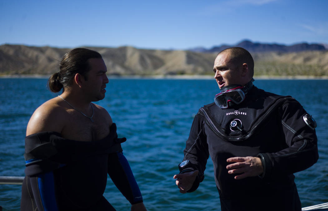 Coast Guard veteran Kris Moorehead, left, and Army veteran Daniel Gililland, both members of WAVES, or Wounded American Veterans Experience Scuba, a nonprofit group that promotes scuba diving for  ...