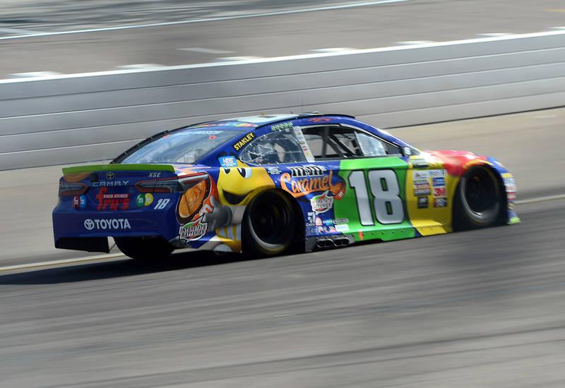 Nov 12, 2017; Avondale, AZ, USA; Monster Energy NASCAR Cup Series driver Kyle Busch (18) races during the Can-Am 500 at Phoenix International Raceway. Mandatory Credit: Joe Camporeale-USA TODAY Sports