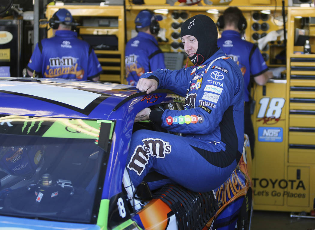 Kyle Busch climbs into his race car before practice for the NASCAR Cup Series auto race at Phoenix International Raceway, Saturday, Nov. 11, 2017, in Avondale, Ariz. Busch will be one of four driv ...