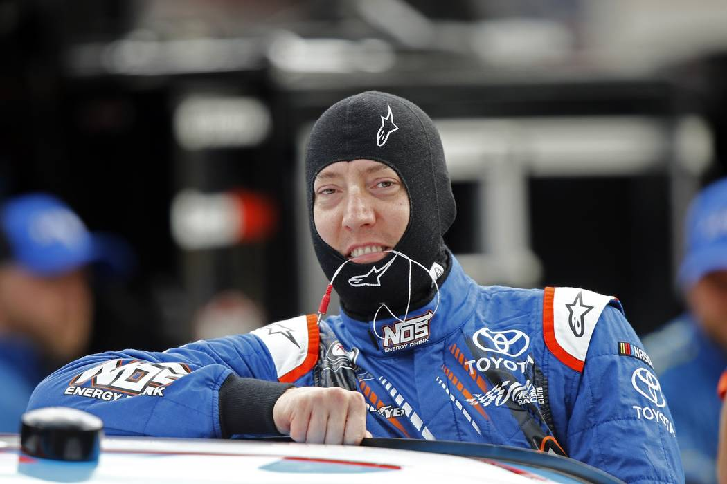 FILE - In this Aug. 17, 2017, file photo, driver Kyle Busch (18) climbs into his car during practice for a NASCAR Xfinity Series auto race on in Bristol, Tenn. In the Cup Series, the finale featur ...