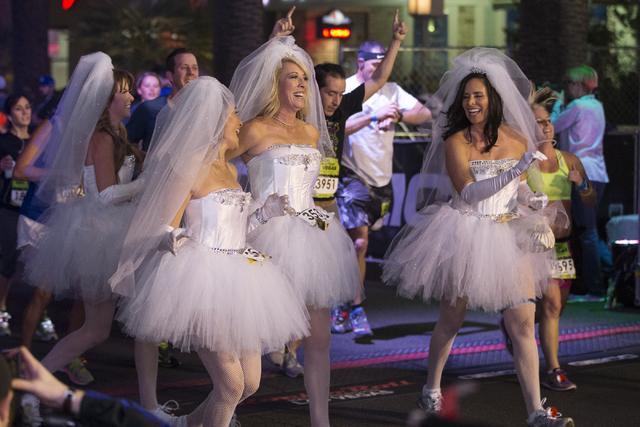 Runners complete the half-marathon run in the annual Rock 'n' Roll Marathon at the Strip near The Mirage hotel-casino on Sunday, Nov. 13, 2016, in Las Vegas. Erik Verduzco/Las Vegas  ...
