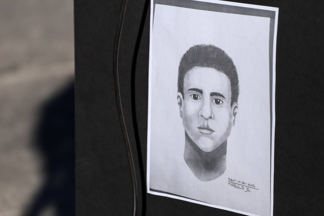 A forensic sketch of a suspect in connection to the severe beating of Shelia Hawkins on Nov. 1 is displayed during a Metropolitan Police Department media briefing at the corner of 11th Street and  ...