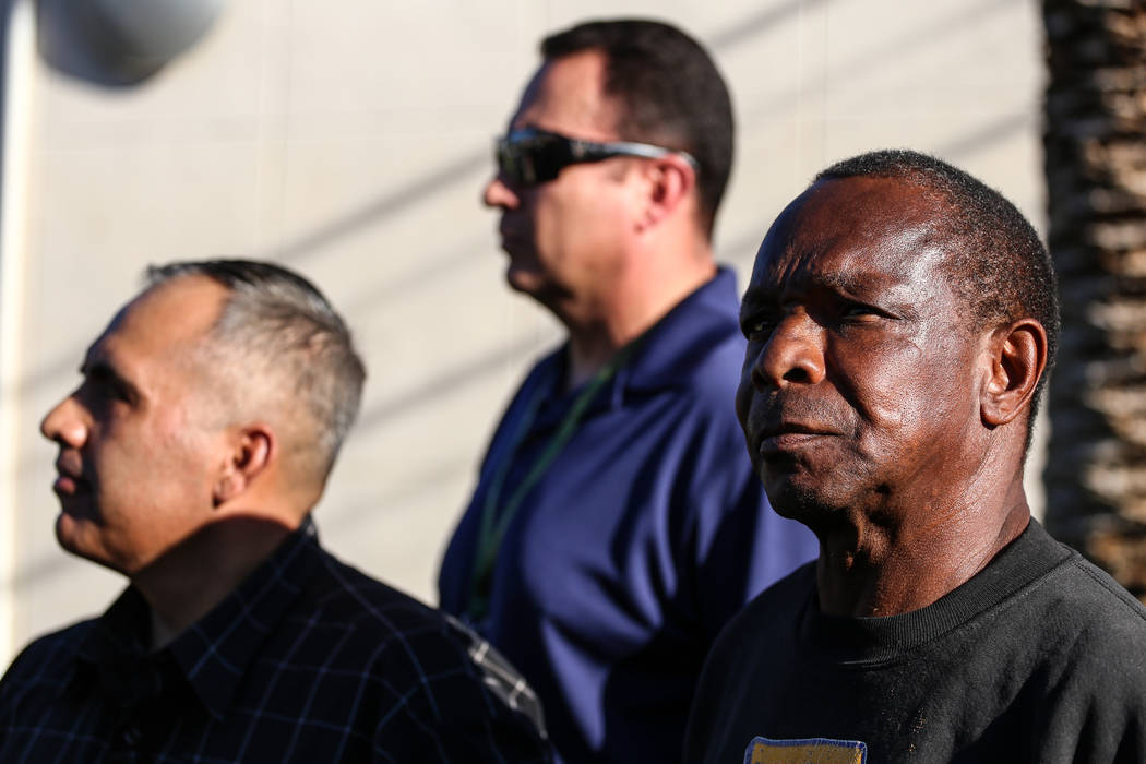 Larry Winslow, right, husband of Shelia Hawkins who was severely beaten on Nov. 1, appears during a Metropolitan Police Department media briefing at the corner of 11th Street and Bridger Avenue in ...