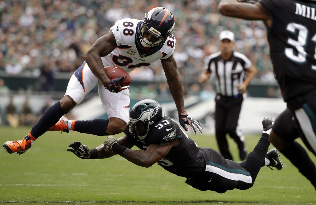Denver Broncos' Demaryius Thomas (88) is hit by Philadelphia Eagles' Nigel Bradham (53) during the first half of an NFL football game, Sunday, Nov. 5, 2017, in Philadelphia. (AP Photo/Matt Rourke)