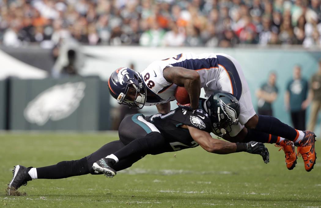 Denver Broncos' Demaryius Thomas (88) is tackled by Philadelphia Eagles' Patrick Robinson (21) during the first half of an NFL football game, Sunday, Nov. 5, 2017, in Philadelphia. (AP Photo/Matt  ...