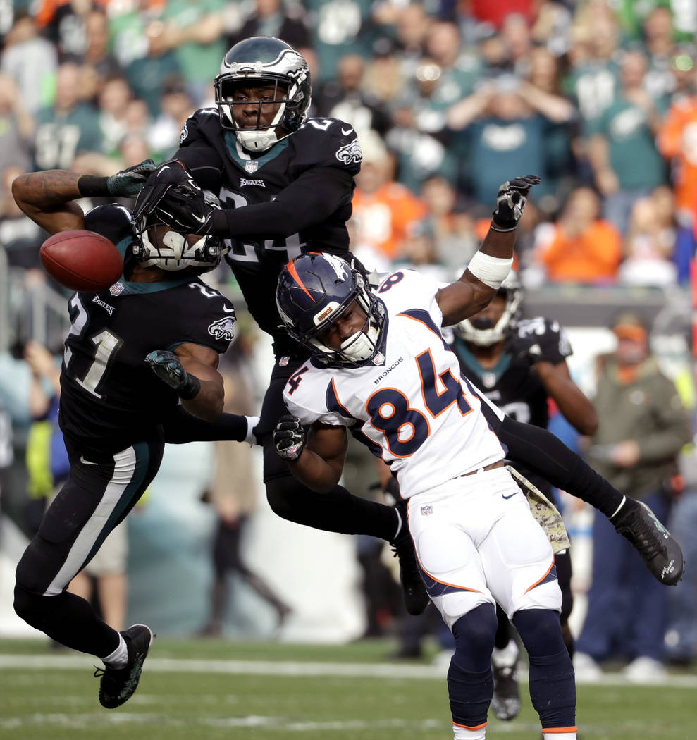 Philadelphia Eagles' Patrick Robinson (21), Corey Graham (24) break up a pass for Denver Broncos' Isaiah McKenzie (84) during the first half of an NFL football game, Sunday, Nov. 5, 2017, in Phila ...