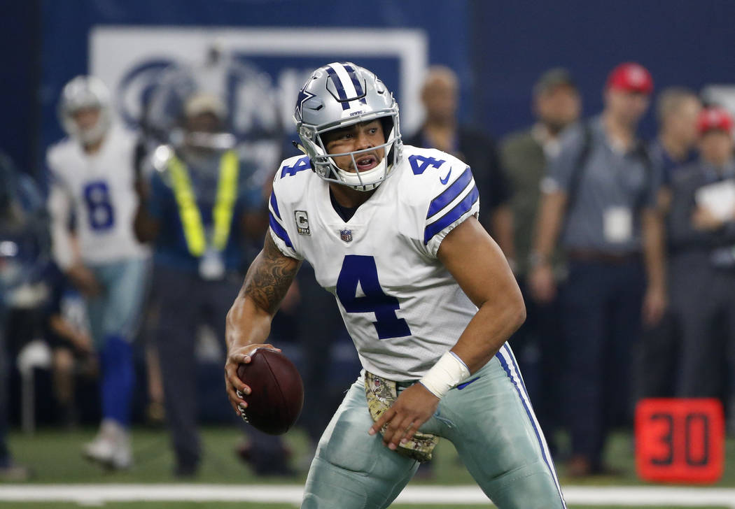 Dallas Cowboys' Dak Prescott (4) scrambles before throwing a pass during an NFL football game against the Kansas City Chiefs on Sunday, Nov. 5, 2017, in Arlington, Texas. (AP Photo/Michael Ainsworth)