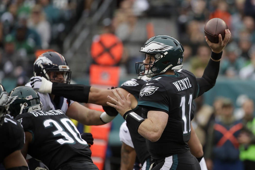 Philadelphia Eagles' Carson Wentz in action an NFL football game against the Denver Broncos, Sunday, Nov. 5, 2017, in Philadelphia. (AP Photo/Matt Rourke)