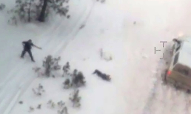 A file still image taken from aerial video released by the FBI on Jan. 28, 2016, shows a law enforcement officer, left, pointing a weapon at Robert 'LaVoy' Finicum, who had just stepped out of the ...