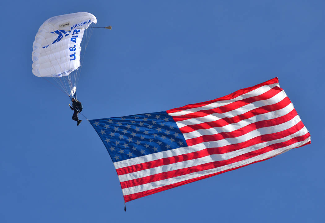 A parachutist bringing in the American flag for the opening ceremony of Aviation Nation 2017 at Nellis Air Force Base in Las Vegas on Friday, Nov. 10, 2017. Brett Le Blanc/Las Vegas Review-Journal