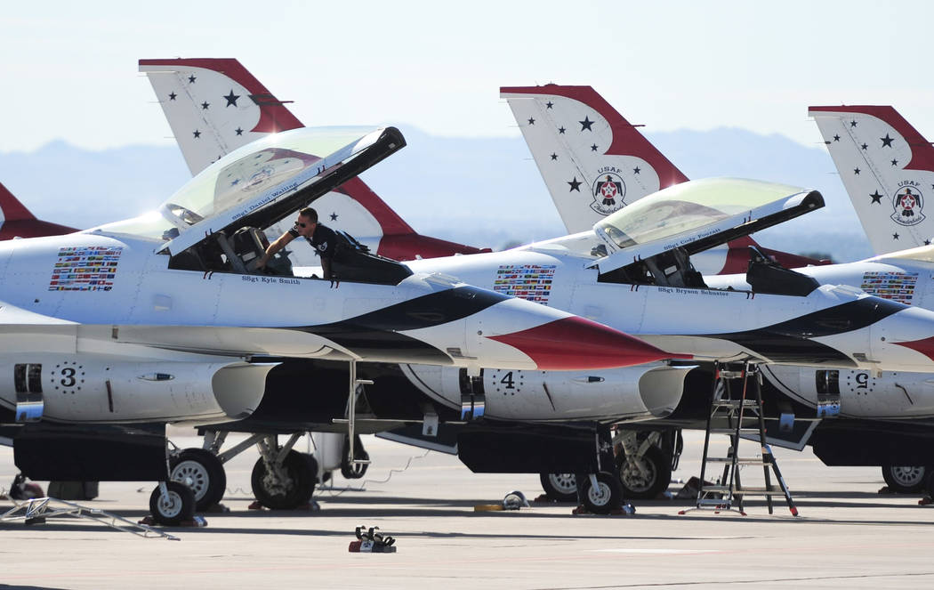 A crew member works on one of the F-16C Fighting Falcon belonging to the Thunderbirds during Aviation Nation 2017 at Nellis Air Force Base in Las Vegas on Friday, Nov. 10, 2017. Brett Le Blanc/Las ...
