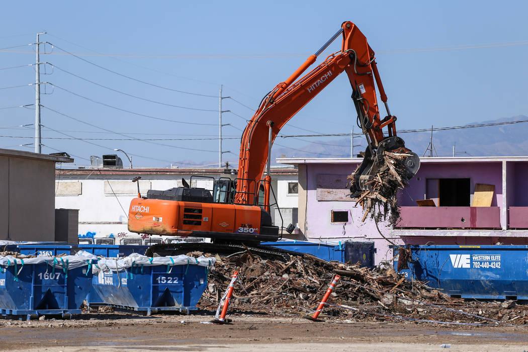 A crane lifts remnants of the demolished Moulin Rouge into dumpsters in Las Vegas, Thursday, Oct. 19, 2017. Joel Angel Juarez Las Vegas Review-Journal @jajuarezphoto