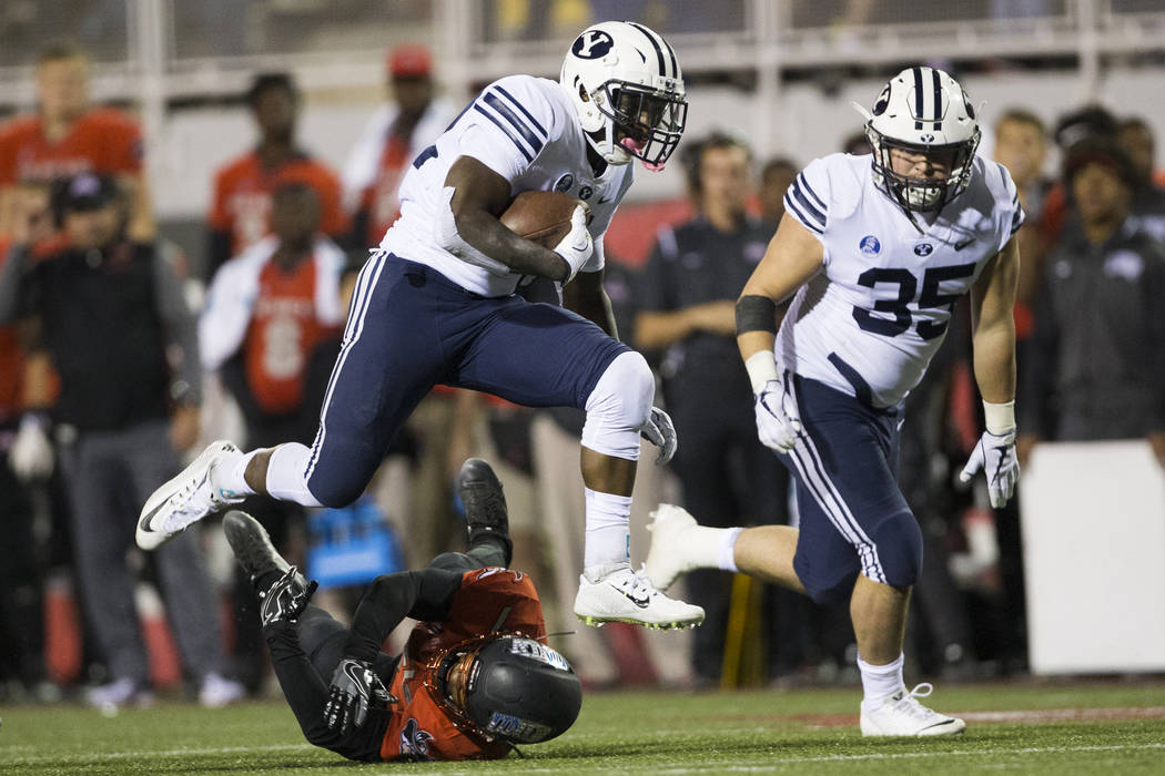 Brigham Young Cougars running back Squally Canada (22) runs the ball against the UNLV Rebels in the football at Sam Boyd Stadium in Las Vegas, Friday, Nov. 10, 2017. Erik Verduzco Las Vegas Review ...