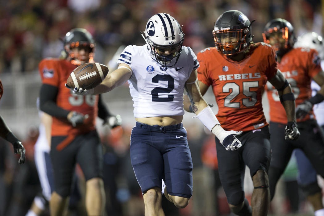 Brigham Young Cougars running back Austin Kafentzis (2) runs the ball for a touchdown against UNLV Rebels in the football at Sam Boyd Stadium in Las Vegas, Friday, Nov. 10, 2017. Erik Verduzco Las ...