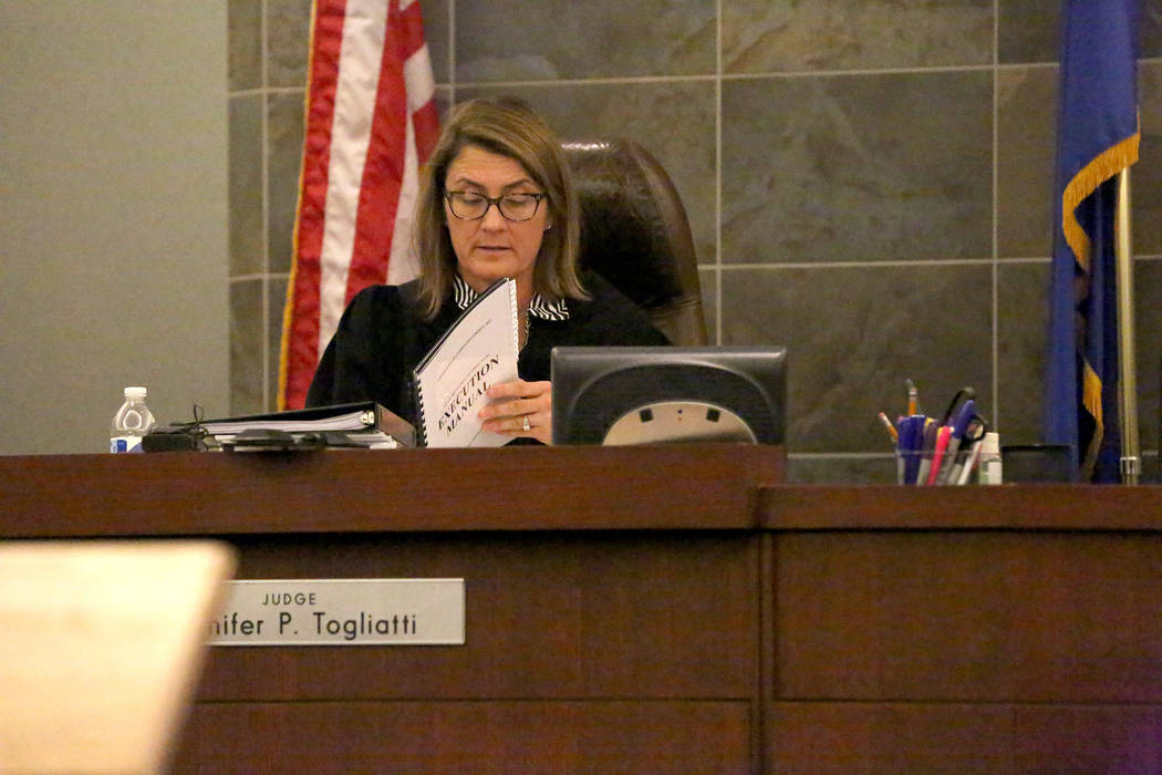 District Judge Jennifer Togliatti reviews protocols in the execution manual during a hearing for Scott Dozier on Wednesday, Nov. 8, 2017, at the Regional Justice Center in Las Vegas. Michael Quine ...