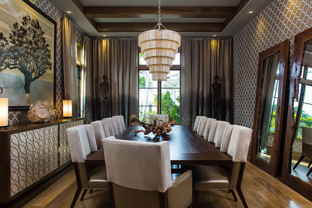 Phillip Jeffries This chic dining room features walls clad in Phillip Jeffries Imperial Gates wallpaper.