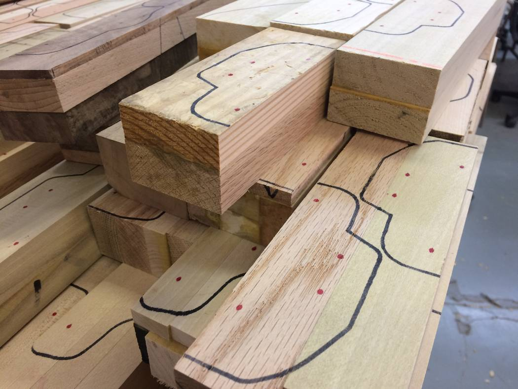 Lumber scraps which will be made into toys are seen Oct. 23, 2017, awaiting the next step of production. Layers of wood are glued together and make for interesting bands of colors on the cars. (Ja ...