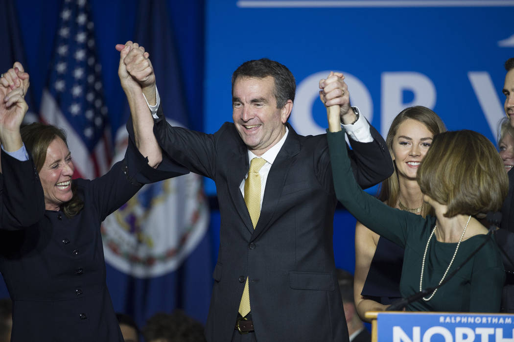 Virginia Gov.-elect Ralph Northam celebrates his election victory with his wife Pam and daughter Aubrey, right, and Dorothy McAuliffe, wife of Virginia Gov. Terry McAuliffe at the Northam For Gove ...