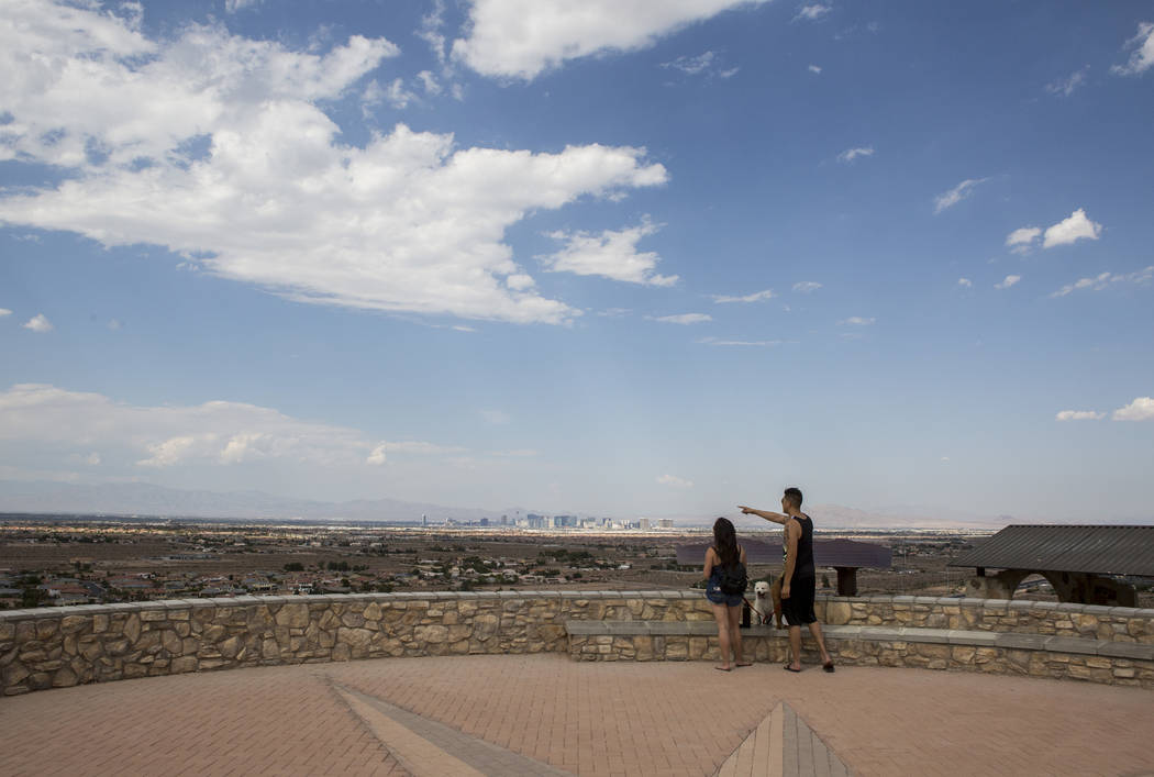 Eric and Rose Chung take in the views at Exploration Peak Park with their dogs Scooby and Furrawrri on Sunday, Aug. 6, 2017. Patrick Connolly Las Vegas Review-Journal
