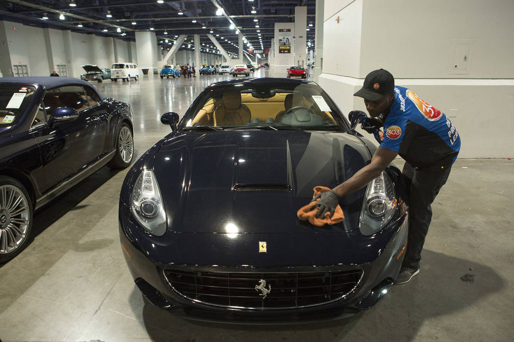 Auto detailer Jeff Burton details a 2010 Ferrari California in preparation for the Mecum Auction, a live auction of collector and classic cars, at Las Vegas Convention Center in Las Vegas on Tuesd ...