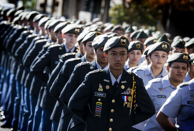 "John Lidang with Valley High School ROTC marches during the Veteran's Day Parade in downtown Las Vegas on Tuesday, Nov.11, 2014. Organizers claim it's the ""largest Veteran's Day parade we ..."