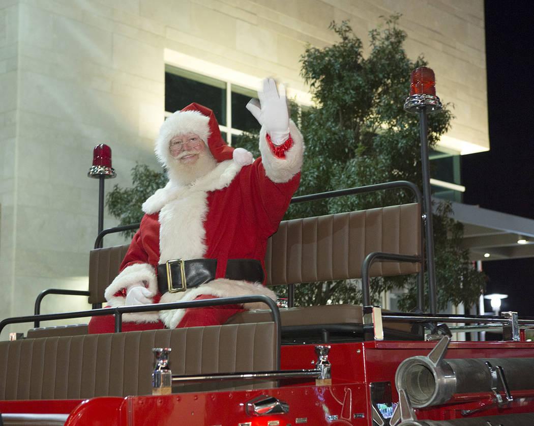 Santa greets visitors at a previous holiday parade at Downtown Summerlin. (Summerlin)